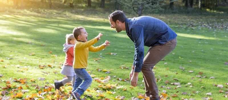 Dad running to children with open arms WEB